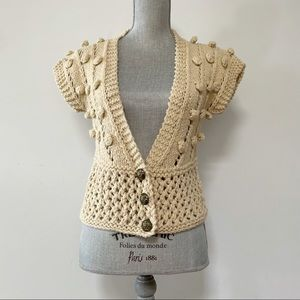 Handmade cropped sweater vest with popcorn detail